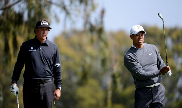 SAN FRANCISCO, CA - JUNE 14: Tiger Woods of the United States watches a shot on the second hole as Phil Mickelson looks on during the first round of the 112th U.S. Open at The Olympic Club on June 14, 2012 in San Francisco, California. (Photo by Harry How/Getty Images)