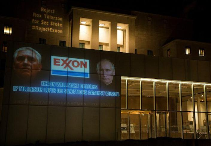 """As the Senate prepares for confirmation hearings for Rex Tillerson as Donald Trump's Secretary of State, a collection of organizations projected """"Reject Rex"""" messages on the side of the State Department Building in Washington, D.C. (Photo: Tim Aubry/Greenpeace)"""