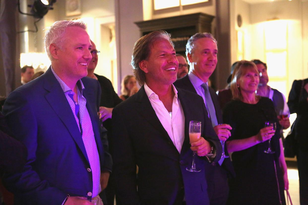 Chief Executive Officer of home furnishings retailer RH. Gary Friedman, center, attends a company event on May 15, 2014 in Greenwich, Connecticut.
