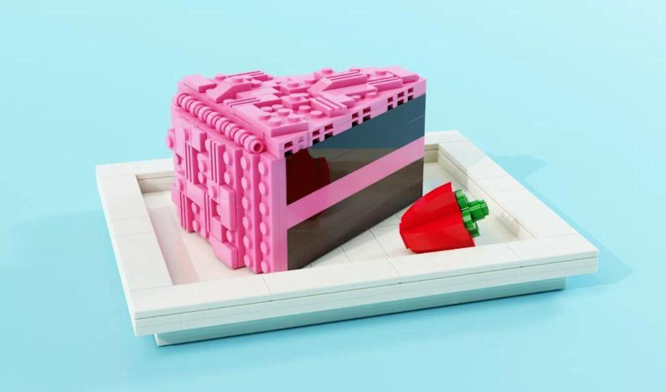 A slice of LEGO chocolate cake with pink frosting.