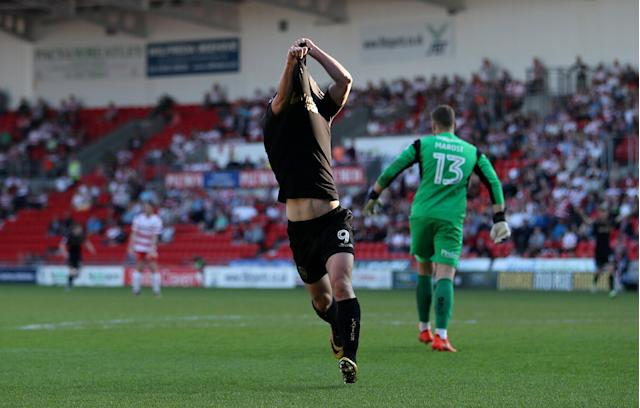 """Soccer Football - League One - Doncaster Rovers vs Wigan Athletic - Keepmoat Stadium, Doncaster, Britain - May 5, 2018 Wigan Athletic's Will Grigg celebrates scoring their first goal Action Images/John Clifton EDITORIAL USE ONLY. No use with unauthorized audio, video, data, fixture lists, club/league logos or """"live"""" services. Online in-match use limited to 75 images, no video emulation. No use in betting, games or single club/league/player publications. Please contact your account representative for further details."""