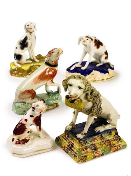 This undated photo provided by Sotheby's shows a group of five seated porcelain dogs that belonged to the late philanthropist Brooke Astor. Sotheby's said the lot will be offered for sale Sept. 24-25, 2012 with some 900 of Astor's personal items from her Park Avenue duplex and her stone manor in Westchester. (AP Photo/Sotheby's)