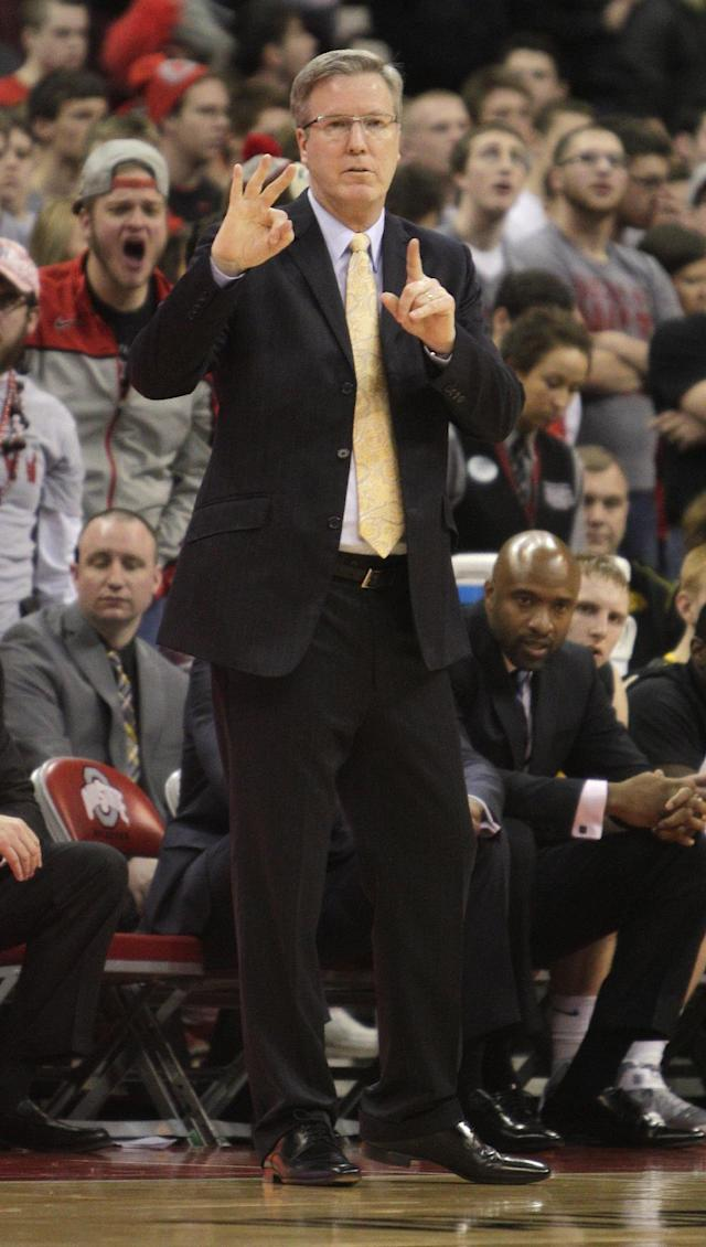 Iowa's head coach Fran McCaffery instructs his team against Ohio State during the second half of an NCAA college basketball game on Sunday, Jan. 12, 2014, in Columbus, Ohio. Iowa won 84-74. (AP Photo/Jay LaPrete)