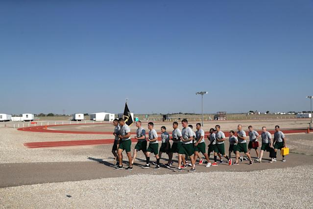 <p>U.S. Border Patrol trainees walk in formation after a physical training class at the U.S. Border Patrol Academy on August 3, 2017 in Artesia, N.M. (Photo: John Moore/Getty Images) </p>