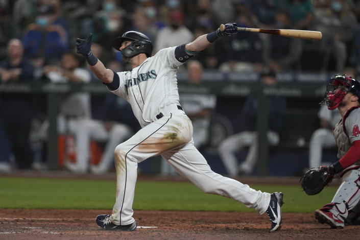 Seattle Mariners' Mitch Haniger follows through on a three-run go-ahead home run against the Boston Red Sox during the seventh inning of a baseball game, Monday, Sept. 13, 2021, in Seattle. (AP Photo/Ted S. Warren)