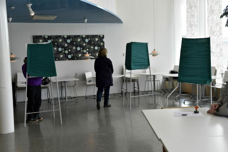 Citizens cast their votes during Finnish parliamentary elections, at the town hall in Manstala, Finland on Sunday, 14th April, 2019. Finns went to the polls in parliamentary elections on Sunday. (Emmi Korhonen/Lehtikuva via AP)