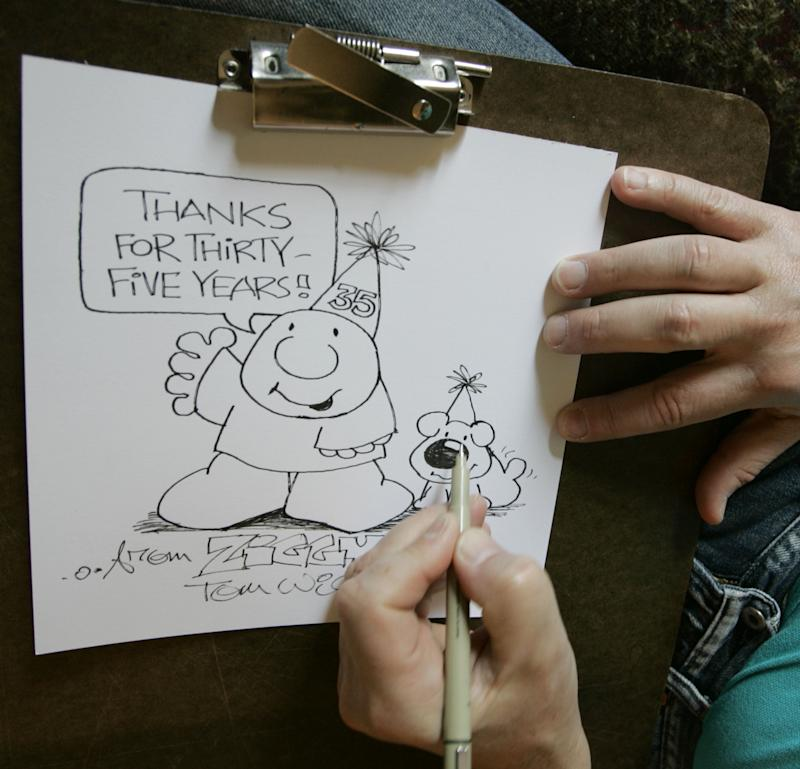 FILE - In this June 23, 2006 photo, Artist Tom Wilson Jr.  draws a Ziggy cartoon celebrating the strip's 35th anniversary at his home in Loveland, Ohio.  Tom Wilson Sr, the creator of hard-luck comic strip character Ziggy has died, he was 80. Spokesman Josh Peres with Universal Uclick, the Kansas City, Missouri, syndication company formerly known as Universal Press Syndicate, says Wilson Sr. died Friday, Sept. 16, 2011 after a long illness. Wilson's son, Tom Wilson Jr., who has produced the panel since 1987, says his father died of pneumonia at a Cincinnati hospital.  (AP Photo/Al Behrman)