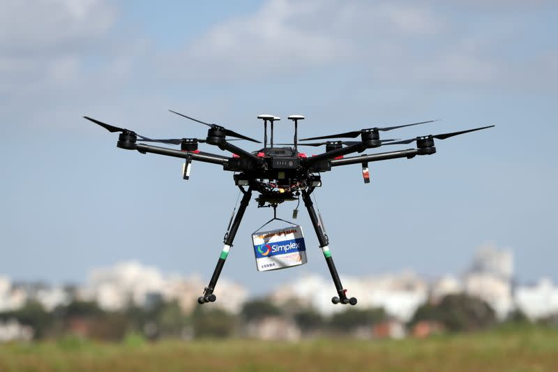 A delivery drone is seen midair during a demonstration whereby drones from various companies flew in a joint airspace and were managed by an autonomous control system in Haifa, near Hadera