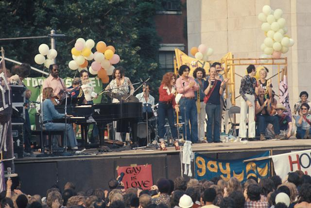 Barry Manilow (seated at piano) and Bette Midler (at center, in red) at a Gay Liberation rally at Washington Square Park on June 24, 1973, in Greenwich Village, New York City. (Photo: Waring Abbott/Getty Images)