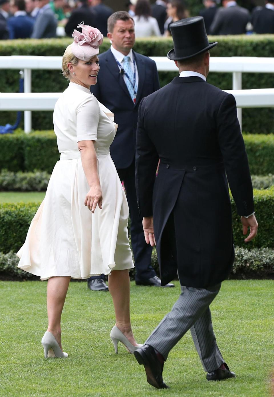 <p>Zara was another royal who attended the races on day three, wearing a white, belted dress and pale pink hat. <br><em>[Photo: PA]</em> </p>