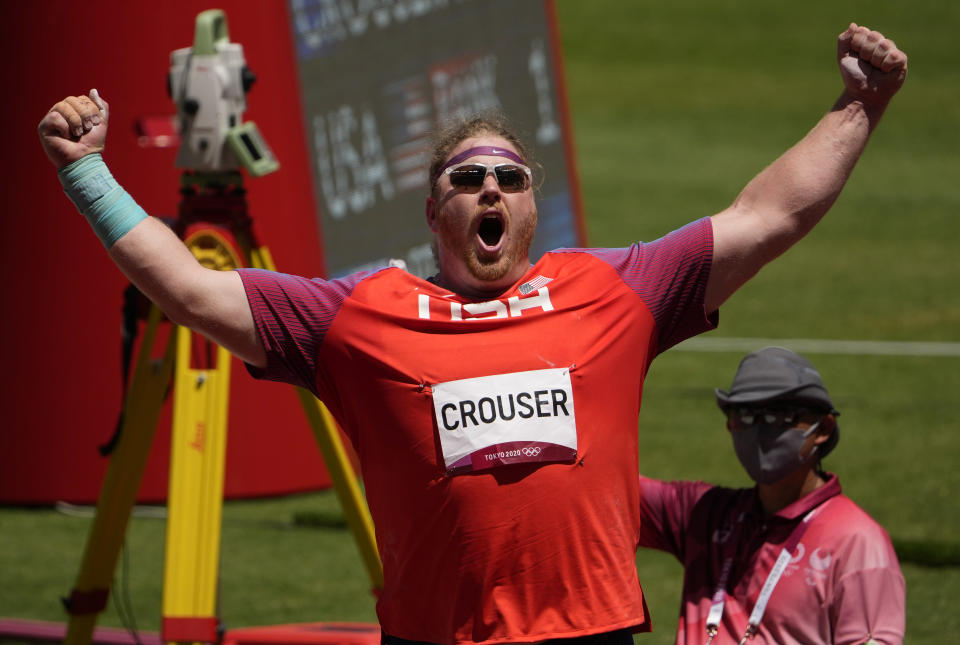 Ryan Crouser, of United States celebrates in the final of the men's shot put at the 2020 Summer Olympics, Thursday, Aug. 5, 2021, in Tokyo, Japan. (AP Photo/Charlie Riedel)