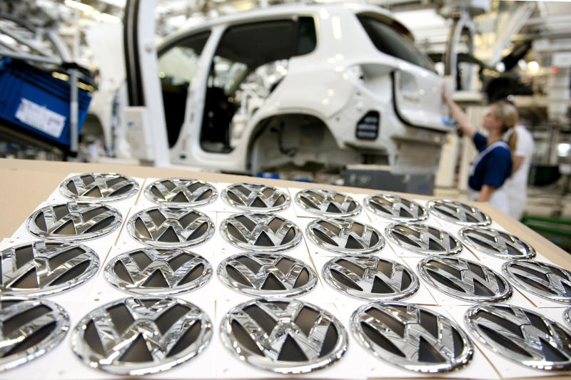 """FILE - In this March 7, 2012 file picture employees work at an assembly line of the Volkswagen factory in Wolfsburg, Germany. German automaker Volkswagen AG says Wednesday, Oct. 24, 2012, net profit rose 58 percent in the third quarter because of an accounting boost from its takeover of Porsche. The company's operating profits fell however. Volkswagen said it was sticking to its earnings forecast despite what it called """"growing headwinds"""" in the business environment. Net profit rose to euro11.38 billion (US dollar 14.80 billion) from euro7.14 billion in the same quarter last year. Sales rose 27 percent to euro48.84 billion. (AP Photo/dapd, Nigel Treblin, File)"""