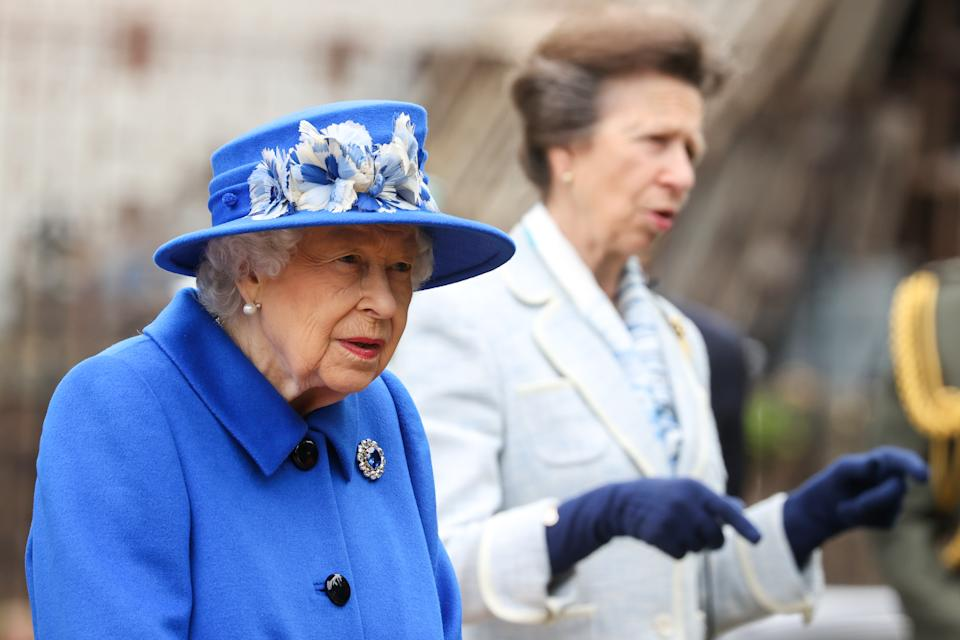GLASGOW, SCOTLAND - JUNE 30: Queen Elizabeth II and Princess Anne, Princess Royal during a visit to the Children's Wood Project on June 30, 2021 in Glasgow, Scotland. The Children's Wood Project is a dedicated green space designed to connect local people with nature, raise aspirations and bring the community together through outdoor activities such as gardening, beekeeping and forest schools. The Queen is visiting Scotland for Royal Week between Monday 28th June and Thursday 1st July 2021. (Photo by Chris Jackson/Getty Images)