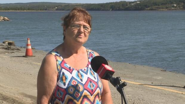 Barbara Tremblett hopes the destruction wrought by Hurricane Larry in her hometown of North Harbour, N.L., will prompt a more robust weather-proofing in the future. (Emma Grunwald/CBC - image credit)