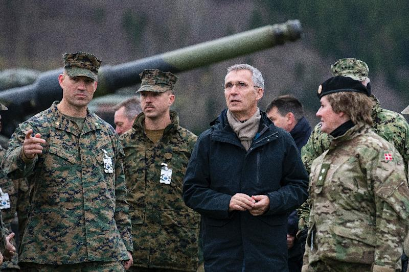 Stoltenberg (pictured centre at a military exercise) insisted that NATO did not want an 'arms race'