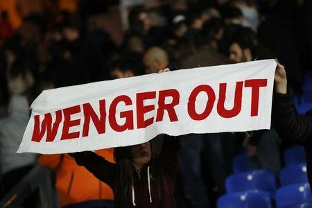 Britain Football Soccer - Crystal Palace v Arsenal - Premier League - Selhurst Park - 10/4/17 Arsenal fan holds up a message directed at manager Arsene Wenger  Reuters / Stefan Wermuth Livepic EDITORIAL USE ONLY.