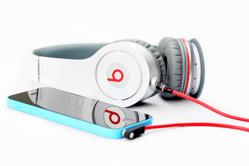 Placentia, CA, USA - June 2, 2014: Beats by Dr. Dre connected to an Apple iPhone 5C on white background, close up.