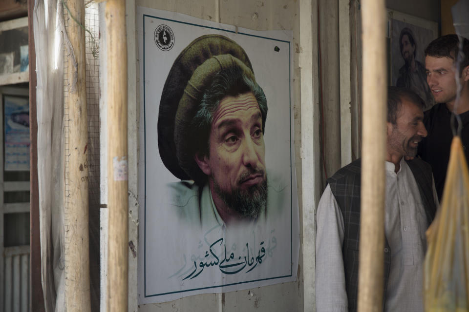 BAZARAK, AFGHANISTAN - SEPTEMBER 5: A picture of the late Afghan commander Ahmad Shah Massoud hangs in a doorway of a shop on September 5, 2016 in Bazarak, Afghanistan. Ahmad Shah Massoud was assassinated on September 9, 2001, in Takhar province by two Arab militants from al Qaeda posing as journalists. Ahmad Shah Massoud is from the ethnic Tajik minority population of Afghanistan. (Photo by Robert Nickelsberg/Getty Images)