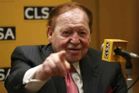 Las Vegas Sands Corp Chairman and CEO Sheldon Adelson points a reporter during a news conference in Tokyo