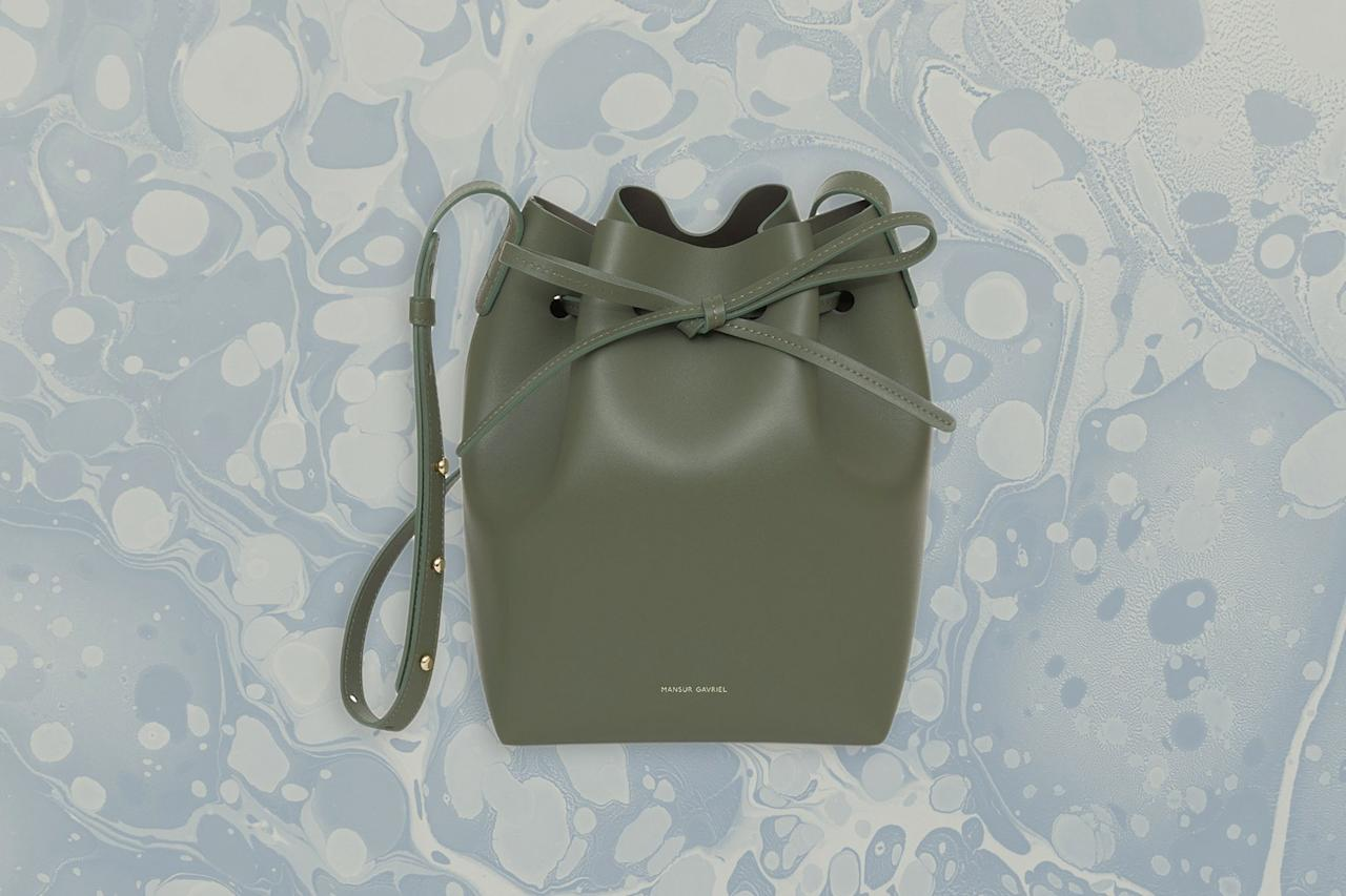 """<p><strong>Best For:</strong> The traveler who can't quite quit bucket bags</p> <p>If you're looking for an elegant cross-body bag, you'll love this mini version of Mansur Gavriel's iconic bucket bag. It has the same classic silhouette as the larger style, with a minimalist feel and subtle details. The drawstring top makes for a chic closure, and the cross-body strap is adjustable, so you can also wear it over your shoulder for a night out.</p> <p><strong>Buy Now:</strong> $475, <a href=""""https://fave.co/2XJfGvb"""" rel=""""nofollow"""" target=""""_blank"""">mansurgavriel.com</a></p>"""
