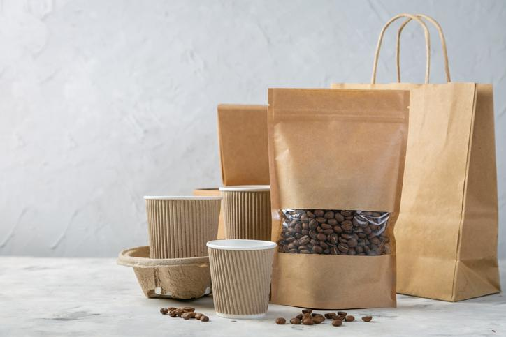 Various brown paper-based bags, cups, and containers.