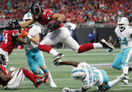 <p>Atlanta Falcons tight end Austin Hooper (81) leaps over Miami Dolphins cornerback Cordrea Tankersley (30) during the first half of an NFL football game, Sunday, Oct. 15, 2017, in Atlanta. (AP Photo/ David Goldman) </p>