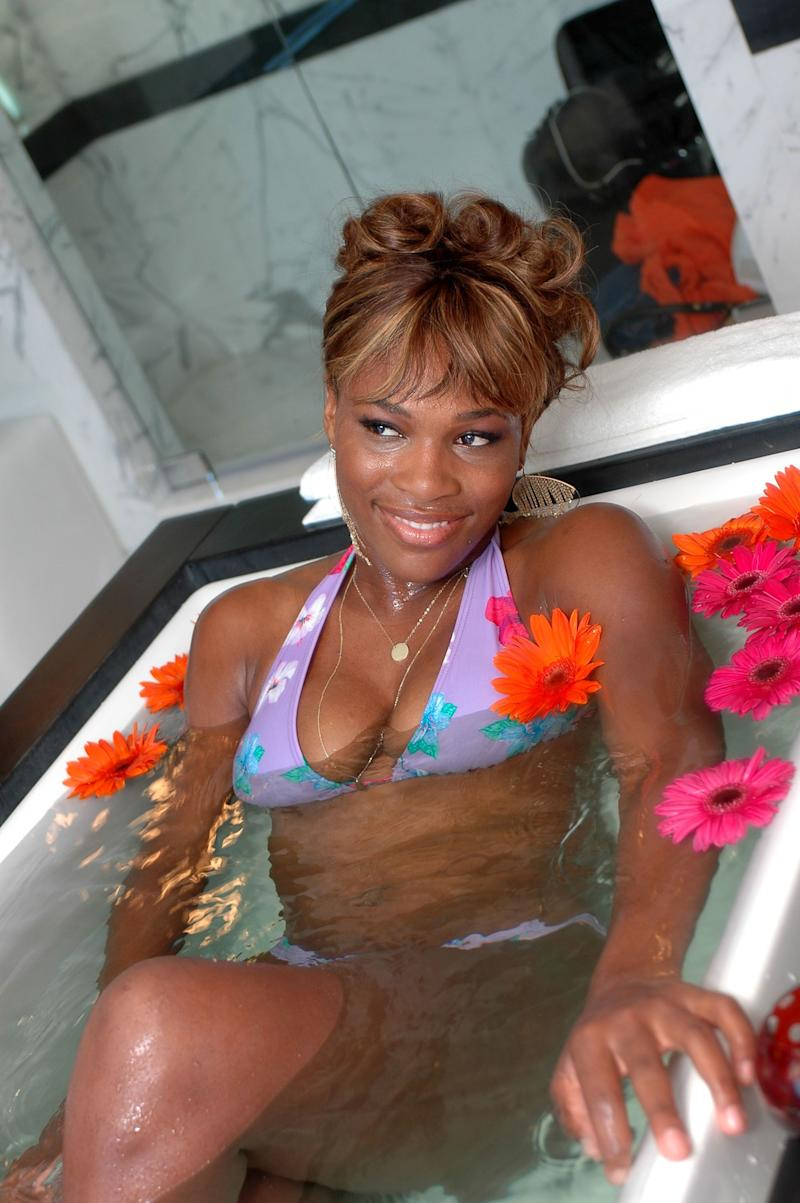 Christening the $5,000 Evian bath in the presidential suite at the Hotel Victor on Feb. 23, 2005, in Miami Beach, Florida.