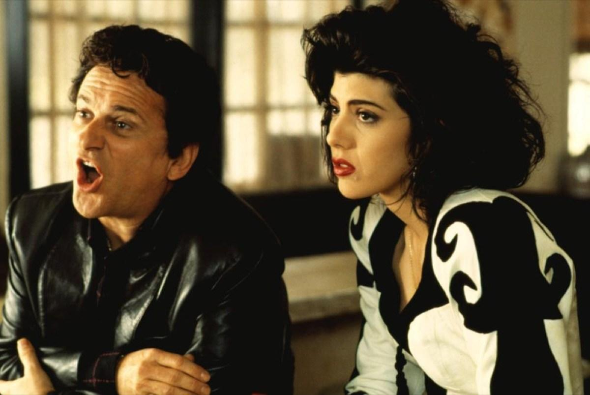 """Sometimes Oscar results are so unexpected that viewers refuse to believe them. That was the case in 1993, when <a href=""""https://www.youtube.com/watch?v=ej8EpWYFhnw"""" target=""""_blank""""><strong>Marisa Tomei</strong> won Best Supporting Actress</a> for her role in <i>My Cousin Vinny</i>. Some people felt both the film and Tomei's performance were forgettable, and rumors sparked that <a href=""""https://mashable.com/2017/02/02/marisa-tomei-oscar-mistake-conspiracy-theory/"""" target=""""_blank"""">her name had been read by mistake</a>. This conspiracy <a href=""""https://www.washingtonpost.com/news/arts-and-entertainment/wp/2017/02/27/one-unexpected-outcome-of-the-oscars-best-picture-blunder-vindication-for-marisa-tomei/"""" target=""""_blank"""">has been debunked</a>, but the internet refuses to let it go to this day."""