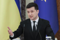Ukrainian President Volodymyr Zelenskiy talks during a joint media conference with European Council President Charles Michel in Kyiv, Ukraine, Wednesday, March 3, 2021. (Sergiy Dolzhenko/Pool via AP)