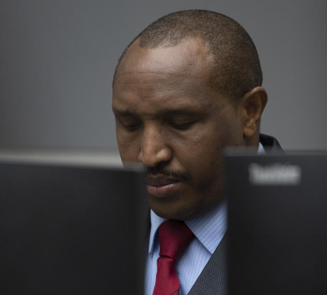 Congolese militia commander Bosco Ntaganda enters the courtroom of the International Criminal Court, or ICC, to hear the sentence in his trial in The Hague, Netherlands, Thursday, Nov. 7, 2019. The ICC delivered the sentence on Ntaganda, accused of overseeing the slaughter of civilians by his soldiers in the Democratic Republic of Congo in 2002 and 2003. (AP Photo/Peter Dejong, Pool)