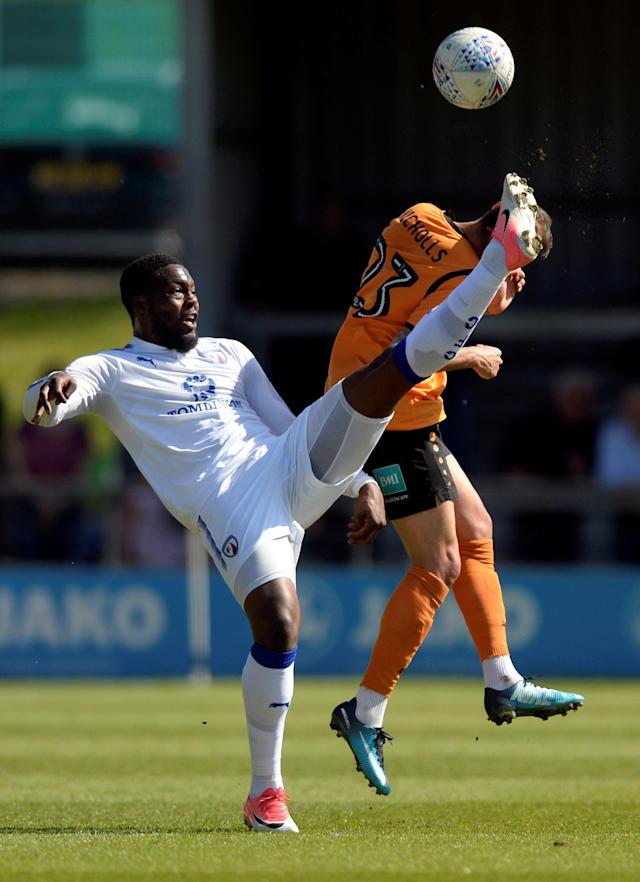 "Soccer Football - League Two - Barnet vs Chesterfield - The Hive, London, Britain - May 5, 2018 Barnet's Alex Nicholls in action with Chesterfield's Jerome Binnom-Williams Action Images/Adam Holt EDITORIAL USE ONLY. No use with unauthorized audio, video, data, fixture lists, club/league logos or ""live"" services. Online in-match use limited to 75 images, no video emulation. No use in betting, games or single club/league/player publications. Please contact your account representative for further details."