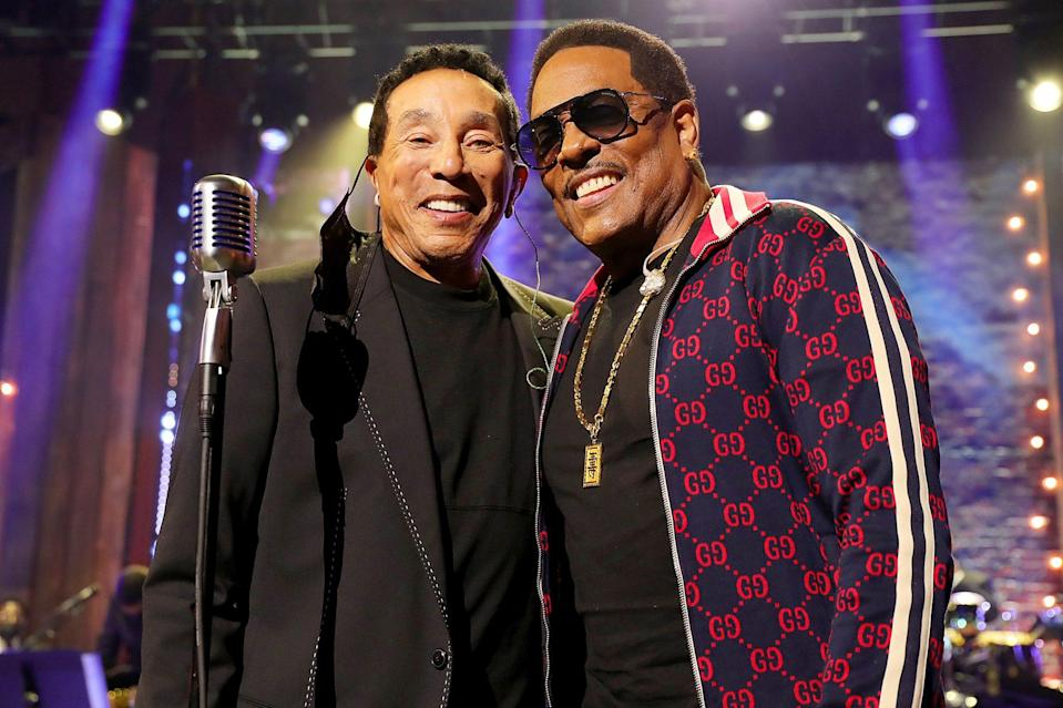 <p>Smokey Robinson and Charlie Wilson pose together at the 2020 Soul Train Awards, presented by BET, on Sunday in L.A. </p>