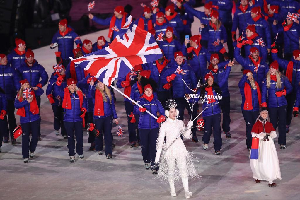 024dbb14c54  p Flag bearer Lizzy Yarnold of Great Britain leads the team