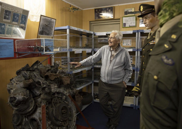 In this photo taken on Thursday, Nov. 7, 2019, Marcel Schmetz shows the motor of a crashed World War II Marauder B-26 at the Remember Museum 39-45 in Thimister-Clermont, Belgium. The museum houses countless World War II objects, but it's most important collection are stories and photos of those who served in World War II, mostly during the Battle of the Bulge. Veterans of the WWII Battle of the Bulge are heading back to mark, perhaps the greatest battle in U.S. military history, when 75-years ago Hitler launched a desperate attack deep through the front lines in Belgium and Luxembourg to be thwarted by U.S. forces.(AP Photo/Virginia Mayo)