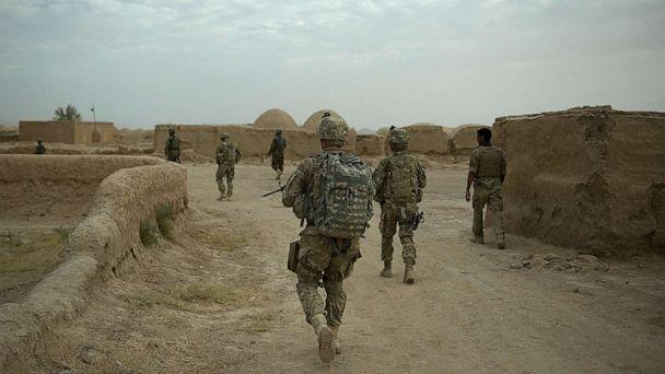 PHOTO: A joint patrol between soldiers from the 1st Platoon, 1-64 Armored Batallion of the U.S. Army,  operating under NATO command, walks through Morghan-Khecha village in Daman district, Kandahar Province, Afghanistan, Sept. 8, 2012.  (Tony Karumba/AFP via Getty Images)