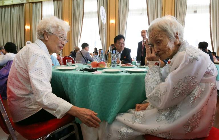 South Korean Cho Hae-do (L), 86, talks with her North Korean sister Cho Sun Do (R), 89, as they bid farewell