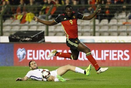 Football Soccer - Belgium v Greece - 2018 World Cup Qualifying European Zone - Group H - Stade Roi Baudouin, Brussels, Belgium  - 25/3/17 Greece's Kostas Manolas in action with Belgium's Romelu Lukaku  Reuters / Yves Herman Livepic