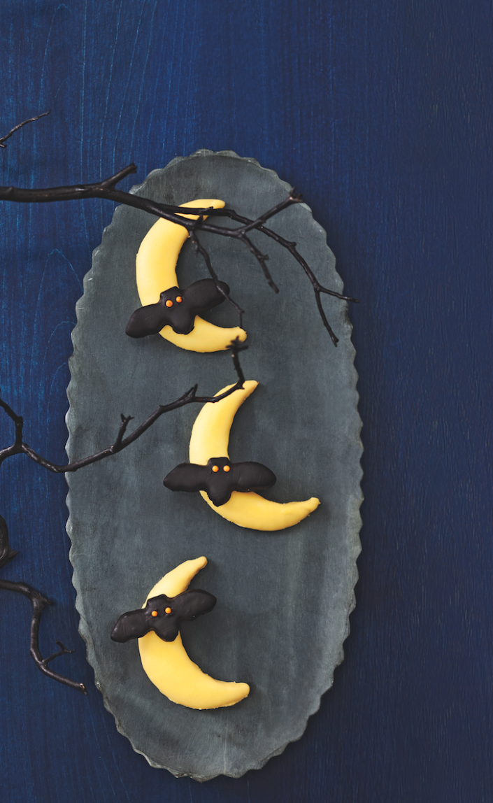 """<p>Don't fret about making your own cookies from scratch. Simply cut out bat and moon shapes from soft chocolate chip cookies and decorate them!</p><p><a href=""""https://www.womansday.com/food-recipes/food-drinks/recipes/a11390/bats-flying-across-the-moon-cookies-recipe-122707/"""" rel=""""nofollow noopener"""" target=""""_blank"""" data-ylk=""""slk:Get the Bats Flying Across the Moon Cookies recipe."""" class=""""link rapid-noclick-resp""""><strong><em>Get the Bats Flying Across the Moon Cookies recipe. </em></strong></a> </p>"""