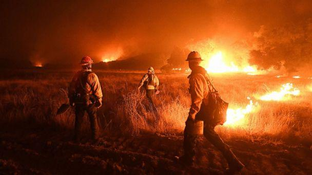 PHOTO: Firefighters light backfires as they try to contain the Thomas wildfire which continues to burn in Ojai, Calif., Dec. 9, 2017. (Mark Ralston/AFP/Getty Images)