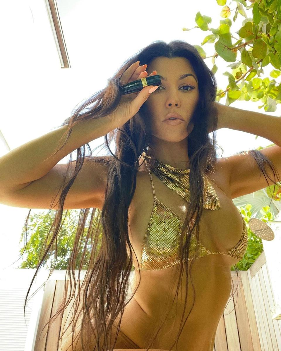 Kourtney Kardashian wears gold bikini