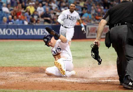 Jul 9, 2018; St. Petersburg, FL, USA; Tampa Bay Rays first baseman Jake Bauers (9) slides safe into home plate as he scores during the seventh inning against the Detroit Tigers at Tropicana Field. Mandatory Credit: Kim Klement-USA TODAY Sports