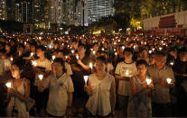 Tens of thousands of people attend a candlelight vigil at Victoria Park in Hong Kong on June 4, 2016, to commemorate victims of the 1989 military crackdown in Beijing. The group, Hong Kong Alliance in Support of Patriotic Democratic Movements of China, that had organized annual vigils in remembrance of victims of the Chinese military's crushing of the 1989 Tiananmen Square pro-democracy protests voted to disband Saturday, Sept. 25, 2021 amid an ongoing crackdown on independent political activism in the semi-autonomous Chinese city. (AP Photo/Kin Cheung)