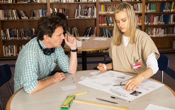 Andrew McCarthy and Taylor Schilling on the set on Netflx's Orange is the New Black. (Credit: Netflix)