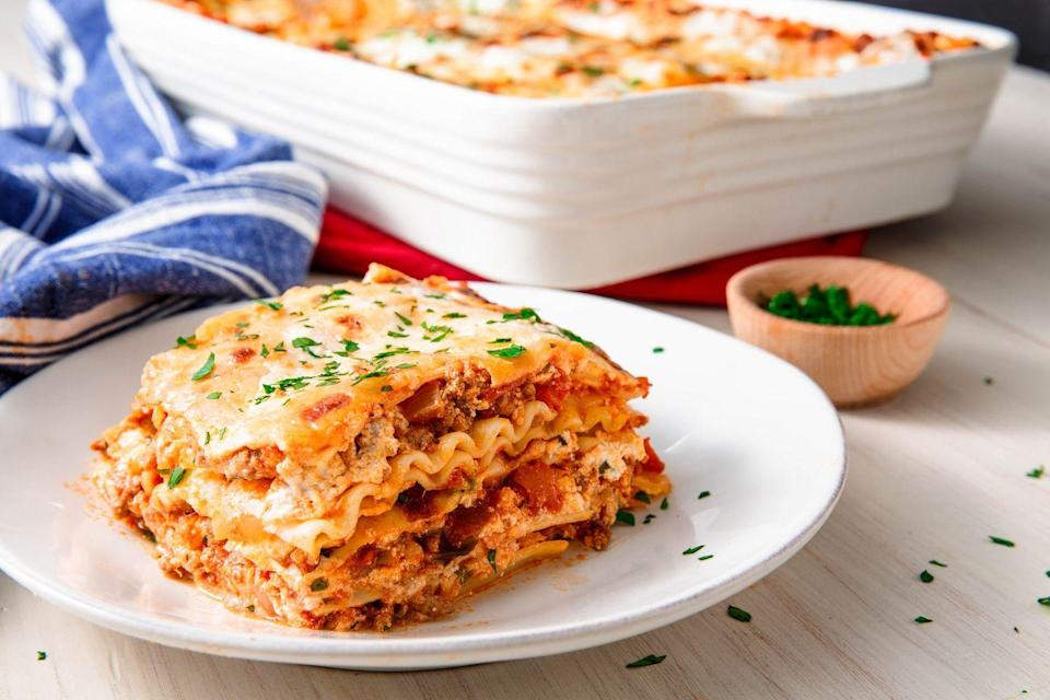 """<p>We took a couple of shortcuts for this recipe by using store-bought pasta sauce and boxed pasta sheets. It saves a ton of time without sacrificing any flavour. </p><p>Get the <a href=""""https://www.delish.com/uk/cooking/recipes/a28831487/classic-lasagne-recipe/"""" rel=""""nofollow noopener"""" target=""""_blank"""" data-ylk=""""slk:Classic Lasagne recipe"""" class=""""link rapid-noclick-resp"""">Classic Lasagne recipe</a>. </p>"""