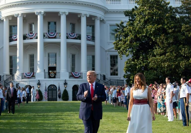 US President Donald Trump, seen here with his wife Melania on the White House's South Lawn, may accept the Republican Party's nomination from the presidential residence