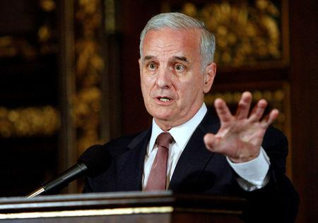 FILE PHOTO: Minnesota Gov. Mark Dayton speaks to media after signing bills to eliminate the state's $5 billion budget deficit and reopen state government and services that have been shut down for three weeks, in St. Paul, Minnesota, U.S. on July 20, 2011. REUTERS/Eric Miller/File Photo