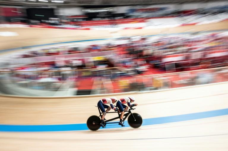 Paralympic tandem cycling pairs a visually impaired para athlete with a sighted pilot partner (AFP/CHARLY TRIBALLEAU)