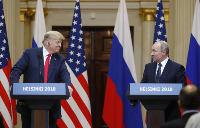 <p>U.S. President Donald Trump, left, looks to Russian President Vladimir Putin during a press conference after the meeting of U.S. President Donald Trump and Russian President Vladimir Putin at the Presidential Palace in Helsinki, Finland, July 16, 2018. (Photo: Alexander Zemlianichenko/AP) </p>
