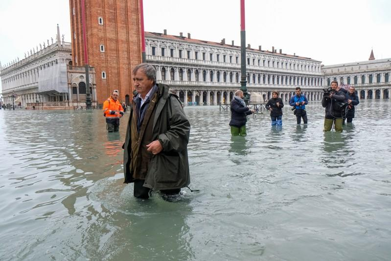 The Mayor of Venice Luigi Brugnaro walks on St Mark's Square during an exceptionally high water levels in Venice