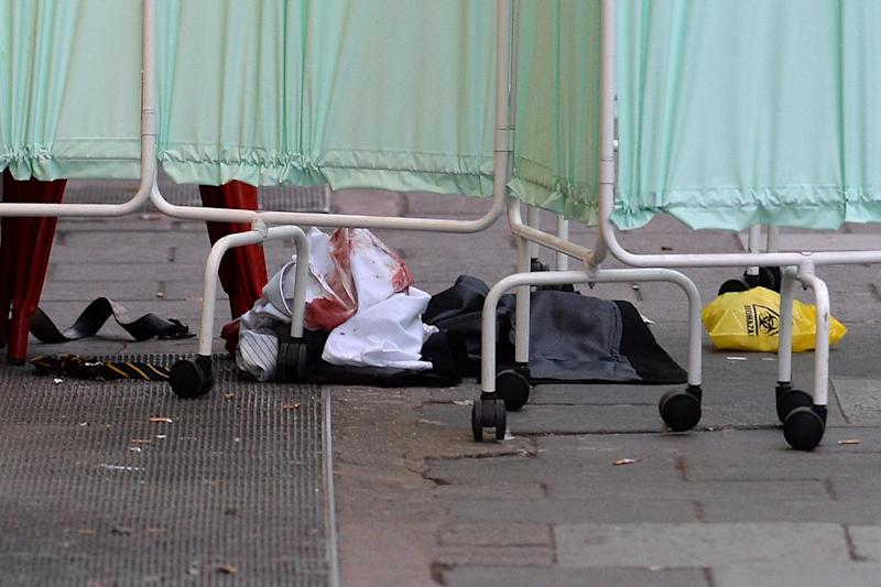 Bloody clothing at the scene outside Victoria Station in central London (PA)